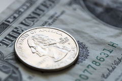 Quarter on US Dollar Bill Royalty Free Stock Image