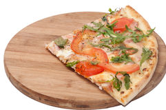 QUARTER VEGETARIAN RUCOLA PIZZA WOODEN BOARD royalty free stock photo