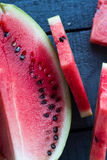 Quarter of watermelon and juicy, sweet slices. Top view Royalty Free Stock Images