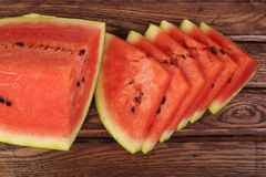 Quarter of watermelon and slices Royalty Free Stock Images