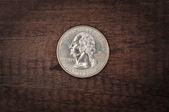 Quarter on Wood. A quarter on wooden background Stock Photos
