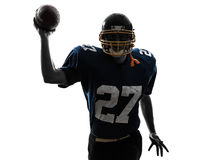 Quarterback american throwing football player man silhouette. One caucasian quarterback american throwing football player man in silhouette studio isolated on Stock Photography