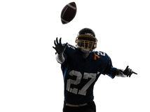 Quarterback american throwing football player man silhouette. One caucasian quarterback american throwing football player man in silhouette studio isolated on Royalty Free Stock Image