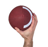 Quarterback Hand and Football Throw. Closeup of a quarterback's hand while throwing a football Stock Photography