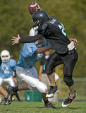 Quarterback sack. Royalty Free Stock Photos