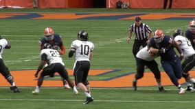 Quarterback Sack, Football Players, Athletes, Sports. Stock video of a football game