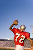 Quarterback throwing football Stock Photography