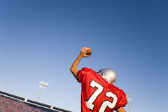 Quarterback throwing football Royalty Free Stock Images