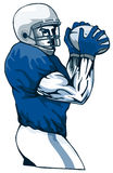 Quarterback throwing pass blue Stock Image