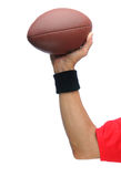 Quarterbacks arm with football Stock Image
