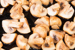 Quartered Roasted Champignons Royalty Free Stock Photos