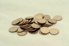 Quarters. A lot of quarters in front of a white background royalty free stock image