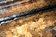 Quarters In An Arcade Game Stock Image