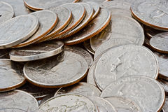 Quarters, Nickels and Dimes. Close up view of American silver colored cash change consisting of quarters, nickels and dimes royalty free stock image