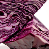 Quarters of a red cabbage. The Quarters of a red cabbage in which you clearly see the textures of the vegetable Royalty Free Stock Photos