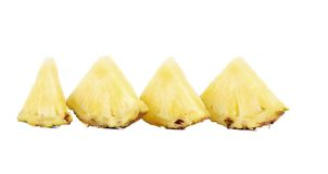 Quarters of slices pineapple in a row. Royalty Free Stock Images