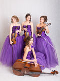 Quartet in evening dresses Stock Photography
