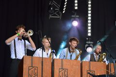 Quartet of horn-blowers performing at festival copacobana Stock Photos