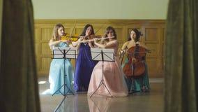 Quartet playing classic music. Woman`s quartet playing classic music stock footage