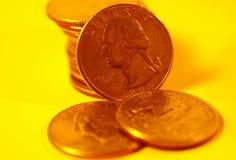 Quarti in goldtone Immagini Stock Libere da Diritti