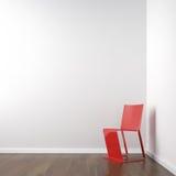 Quarto de canto branco com cadeira vermelha Fotos de Stock Royalty Free