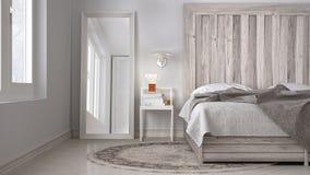 Quarto de DIY, cama com cabeceira de madeira, eco branco escandinavo c fotografia de stock royalty free