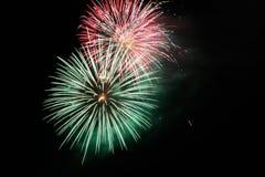 Quarto de fogos-de-artifício de julho na noite Fotografia de Stock Royalty Free