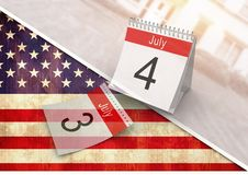 quarto del calendario di luglio contro la bandiera americana Fotografia Stock