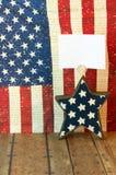 Quarto della stella di luglio con lo spazio della copia con un backgr della bandiera americana Fotografie Stock