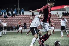 Quarts de finale de tasse de roche du Gibraltar - le football - Manchester 62 0 Photographie stock