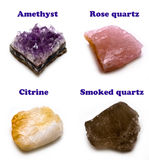 Quartz. Four varieties of rough quartz: amethyst, rose-quartz, citrine and smoked quartz Royalty Free Stock Photos