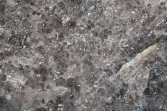 Quartz background. Backside of a piece of smoky quartz crystals Royalty Free Stock Photo