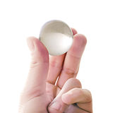 Quartz ball in fingers Stock Images