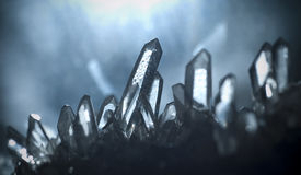 Quartz cave. Macro picture of some quartz gems shot in a cave. Natural light irradiates the crystals Stock Photography