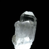 Quartz crystal. White light within a quartz crystal against black Stock Images