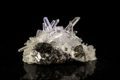 Quartz crystal in front of black Stock Photo