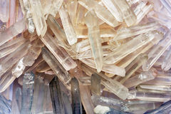Quartz crystals backdrop. Natural quartz crystals in the form of ice shards Royalty Free Stock Photo