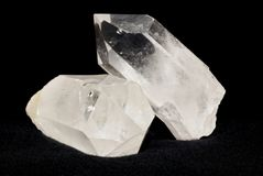 Quartz crystals on black. Quartz crystals laid on black textile. Quartz is used in esoteric and also in alternative medicine royalty free stock image