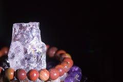 Quartz geode with semiprecious gemstone bracelets charging, spirituality concept, alternative medicine Royalty Free Stock Images