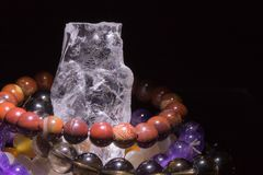 Quartz geode with semiprecious gemstone bracelets charging, spirituality concept, alternative medicine Royalty Free Stock Photo