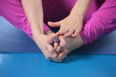 Quartz heart in a woman's foot. Practicing yoga Stock Image