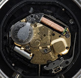 Quartz mechanism of watch, battery, coil Royalty Free Stock Photography