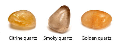 Quartz minerals. 3 quartz stones  on white background:citrine quartz, smokey quartz, golden quartz Royalty Free Stock Photo