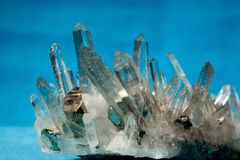 Quartz with pyrite fools gold crystals grown on. Big quartz crystals (rock crystal) with iron pyrite (fool's gold) crystals grown on stock images