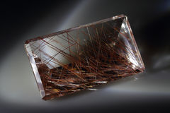 Quartz with rutile. Cut stone Stock Photo