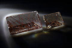 Quartz with rutile. Cut stone Royalty Free Stock Image