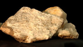 Quartz and tiff crystals and basalt with quartz. Loopable turning of tiff and quartz chrystals and basalt with intergrown pieces of prismatic quartz crystals stock footage