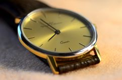 Quartz watch. On yellow background Stock Image
