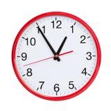 Quasi un'ora su un fronte di orologio rotondo immagini stock libere da diritti