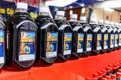 QUATLAM NATIONAL COUNTRYSIDE CUISINE FESTIVAL, NAMDINH, VIETNAM - DECEMBER 7, 2014 - Bottles of local fish sauce on display. Royalty Free Stock Photo